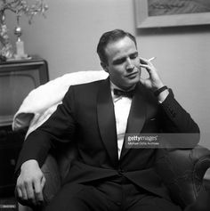 Actor Marlon Brando smokes a cigarette as he attends a party on February 24, 1955 in Los Angeles, California.