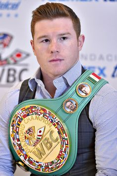Canelo Alvarez presented with the WBC middleweight world. Canelo Alvarez presented with the WBC middleweight world… Saul Canelo Alvarez, Ufc, World Boxing Council, Sparring Gloves, Professional Boxing, Boxing History, Boxing Champions, Sports Figures, First Humans