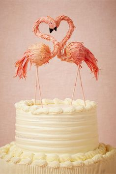 Flaming Flamingo Cake Topper from BHLDN. Handmade by artist Ann Wood.