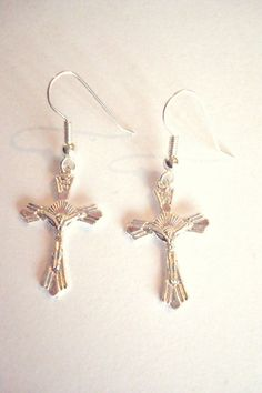 BNWOT Bright Silver Tone Alloy Small Crucifix Cross Dangle Drop Earrings found…