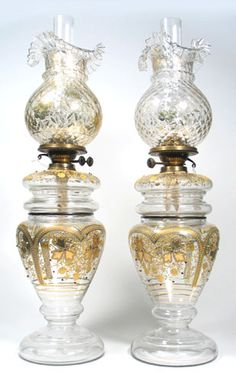 These are beautiful Oil Lamps with tall glass decorative chimneys and the gold decorative base is amazing.