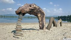 land art driftwood lake monster in hungary by tamas kanya
