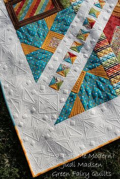 by Judi Madsen at Green Fairy Quilts.  The quilting on this is magnificent!
