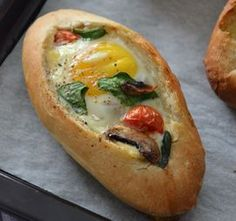 Breakfast Egg Boats ~ small buns or baguettes sliced and filled with cherry tomato, spinach, mushrooms, and cheese, then topped with an egg and baked in the oven ~ nutritious & easy brunch Egg Boats, Healthy Snacks, Healthy Recipes, Tasty Meals, Healthy Cooking, Vegetarian Snacks, Avocado Recipes, Egg Recipes, Easy Cooking