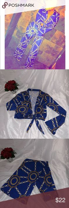 Trendy 2 pc outfit Very Popular Royal Blue 2pc  Outfit Never Worn ‼️ Polyester/ Spandex blend Will fit curves nicely Slight Flare on sleeves and pants    Top can be worn tied or open  Trendy chain printed design kadore' boutique Tops Blouses