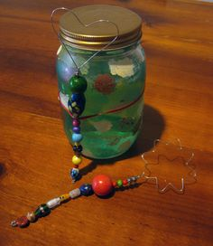 Make your own bubble wand & give it with a jar of bubble solution.