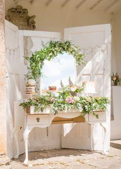 cake table with greenery, photo by Wedding Belles http://ruffledblog.com/english-countryside-wedding-inspiration #weddingideas #caketable #desserttable