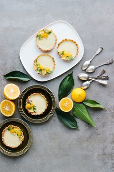 Easy plant-based, dairy, egg, soy & gluten free individual vegan lemon tarts with a raw base of almonds, dates & coconut.