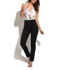 88f851143269 Look what I found on  zulily! White Floral Surplice Jumpsuit  zulilyfinds  Jumpsuit