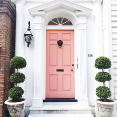 This posh doorstep is so cute! We love seeing all the places that people call home, this door is definitely pretty in pink!