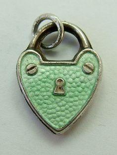 Edwardian silver and enamel puffed padlock charm.