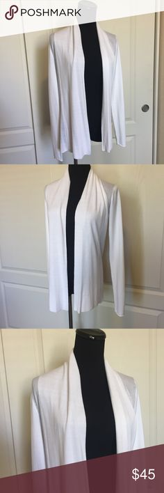 """Express Soft Ivory Open Front Cardigan Sweater XS Express open front cardigan sweater in Soft Ivory. Size XS. Excellent condition. Worn once. No flaws. The material is soft, lightweight and stretchy. Long sleeves. A light, easy-wear layer of deliciously soft knit to complement your ensemble. Contrast its drapey shape by tossing it on over denim leggings and a fitted tee or cami. Body: 100% rayon. Sleeves: 80% rayon 17% nylon 3% spandex. Approx 27"""" long. Smoke-free home. No trades. Offers…"""