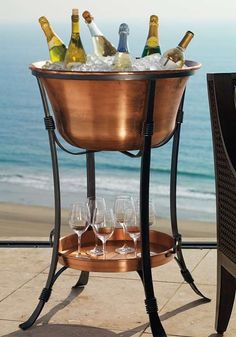 Keep your beverages ice cold while entertaining this summer with the Copper Beverage Tub with Tray; a handsome and functional party piece.