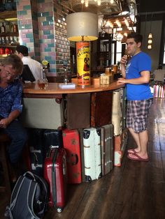Train station bar...made from suitcases!