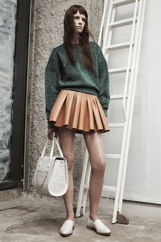 Alexander Wang - beautiful pleated leather mini in the perfect caramel color paired with the right emerald green lurex sweatshirt- killer combo