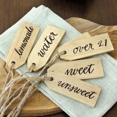 use wooden tags to label party beverages! so simple and cute.