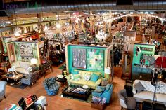 Now THIS is a shop, and a shop photo, to aspire to! It's Leon & Lulu What TGtbT.com loves about this: the room vignettes breaking up the warehouse feel.