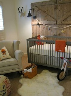 rustic nursery.... I love the door idea love love love, I just hate the fur rug and goat on the wall..