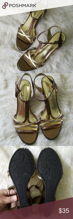 Etienne Aigner Sandals Gold Strappy sandals from Etienne Aigner.  Slight wedge and adjustable ankle straps.  In Like New condition. Etienne Aigner Shoes Sandals