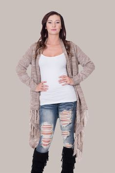 This light weight, warm & cozy Taupe and Cream fringed cardigan is awesome because of it's basic taupe and cream color which makes dressing it up super simple and easy. Light weight easy to layer with and runs a little big to give that warm cozy look!  Casey is a size 3/4, height 5'6 and is wearing a small/medium | Shop this product here: spree.to/aw9z | Shop all of our products at http://spreesy.com/Diva_styles    | Pinterest selling powered by Spreesy.com