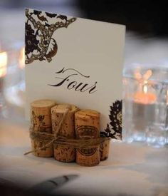 cork table numbers; could even glue the bottom instead of using the burlap string....could give me a reason to start drinking more wine!! ;)