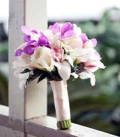 Calla lily bouquet with purple orchid accents...no red but you can customize. Still pretty <3