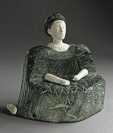 Une des « princesses de Bactrianne » provenant du nord de l'Afghanistan, typique de la civilisation BMAC. Statuette composite, Calcite blanche et stéatite verte. 2500-1500 avant J.C..