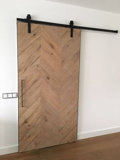When homeowners first hear about the possibility of using barn doors as interior doors in their home, the initial image that springs to mind may be substantially different than the reality. Metal Barn Homes, Metal Building Homes, Pole Barn Homes, Pole Barns, Diy Barn Door, Diy Door, Sliding Door Window Treatments, Pole Barn House Plans, Media Room Design