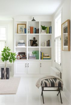 A built-in bookshelf nestled in a white-washed Connecticut living room.
