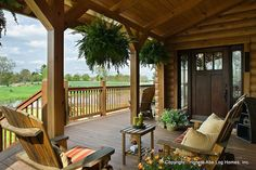 Exterior, horizontal, front porch with outdoor furniture, Wilson residence, Crossville, Tennessee; Honest Abe Log Homes