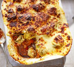 Use gluten free flour for the sauce and you're good to go with this hearty spiced lamb moussaka with artichoke hearts, a cherry tomato ragu and layers of fried aubergine and potato. Veggie Moussaka, Moussaka Recipe, Lamb Shanks Slow Cooker, Musaka, Bbc Good Food Recipes, Meal Recipes, Greek Recipes, Kitchens