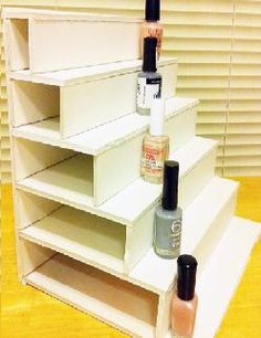 Make your own nail polish rack with just some cork board and glue. Then design it with washi tape! : )