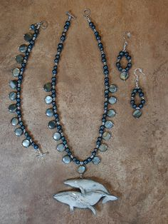 Artist Carol Spraker's RainEye Studio, Wearable Art Jewelry and Sculptures