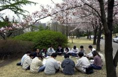 A POSTECH class conducted outdoors during the springtime.