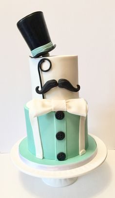 Little gentleman first birthday cake! Top hat, mustache, suspenders, bow tie, spectacle, teal, black & white