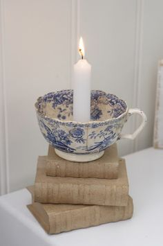 Love old books, blue transferware and candles!`````old bleu transferware! Blue And White China, Blue China, Deco Originale, Candle Lanterns, Delft, My Favorite Color, Favorite Things, Fabric Flowers, Shades Of Blue