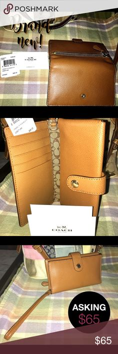"**NWT** AUTH COACH Crossgrain Leather Phone Clutch In saddle with imitation gold hardware, This bifold phone clutch has snap closure across top. Wallet-type phone case with one side for storing cell and the opposite side has 5 card slots and one slip pocket. Gusseted zip coin purse on back. 6"" leather strap that is easily tucked in when not in use. Interior comes with signature coated canvas in middle and brown twill fabric in slots. NEW WITH TAGS!! MINT CONDITION!! NEVER USED!! GREAT…"