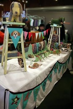 craft fair presentation idea - I never would have thought to use stools!