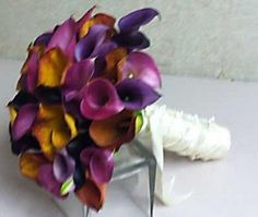 I love the colours of this. Deep purple and orange calla lilies