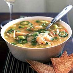 Quick Spicy Shrimp Soup•4c chick.broth•2c water•1½c cooked rice rice or froz.chinese dumplings•1T oil•1t minced garlic•½crushed red pepper•1½lb large shrimp•4 lime wedges  •Optional:bean sprouts,scallions,cilantro,jalapeño,spinach.•
