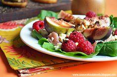 Salada de rúcula, presunto de parma, queijo de cabra, figos frescos, framboesas, nozes e creme de balsâmico