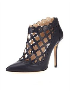 """FERNANDA, $995.00 Coined the Fernanda, this patent leather bootie is the latest addition to the collection. Inspired by latticework, these laser-cut shoes are sweetened with scalloped trim. The edgy-yet-elegant silhouette will elevate your wardrobe from day to night. Designed in New York and crafted in Italy using the finest materials.  • 4"""" heel  • 100% leather  • Runs true to size  • Italian sizing  • Made in Italy"""