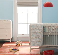 Dwell Studio's captured city cool with this blue, grey, and orange nursery.