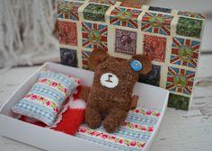 Teddy bear in a match box. Cute.