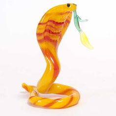 New Products. Glass Cobra with Flower Figure is a hand-blown glass figurine which is made... http://russian-crafts.com/glass-figurines/glass-reptiles/glass-snake-cobra.html