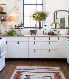 A Rental Kitchen Spiffed-Up with Leather Cabinet Pulls