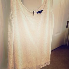American eagle tank Cute white american eagle tank with flowers and a zipper in the back.  Worn a couple times.  In excellent condition and has no stains or tears.  Reasonable offers are welcome! American Eagle Outfitters Tops Tank Tops
