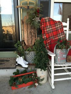 Front Porch Winter Decor, Metal Tool Box. Ice Skates. Olive Basket. Galvanized Watering Can. Vintage Sled. Red Wing Crock. Christmas