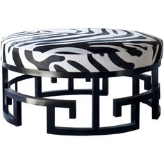 Jeannie Round Ottoman from the Kountouris Collection. Greek key inspired base with cow hide zebra upholstered top.