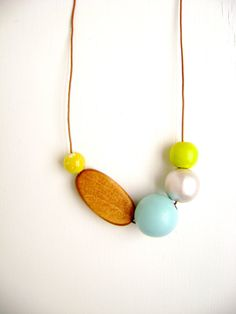 Asymmetrical light blue / yellow / pearly white wooden bead necklace / boho jewelry / statement necklace on Etsy, $25.00